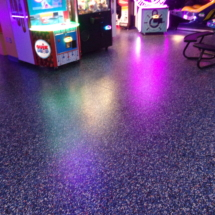 arcade epoxy floor with glow flakes picture
